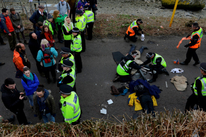 Protesters against the renewal of Trident and Nuclear arms at Faslane Naval Base made their views knowns with about 30 chaining themselves to each other outside the naval base.