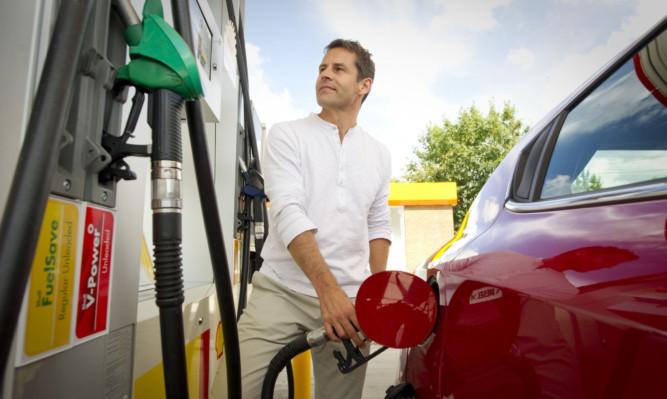 A motorist fills up at the pumps.