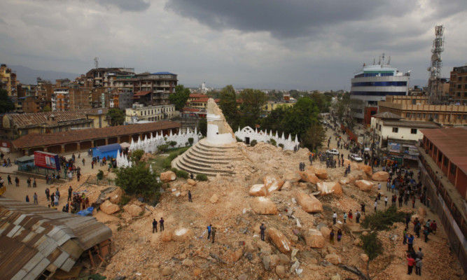 One of the Kathmandu 's landmark Bhimsen tower is seen in rubbles after it was damaged in Saturdayís earthquake, in Kathmandu, Nepal, Sunday, April 26, 2015. The earthquake centered outside Kathmandu, the capital, was the worst to hit the South Asian nation in over 80 years. It destroyed swaths of the oldest neighborhoods of Kathmandu, and was strong enough to be felt all across parts of India, Bangladesh, China's region of Tibet and Pakistan.