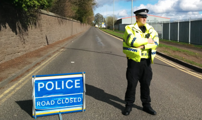 Police closed off a section of Liff Road and access to Whittle Place after an ammonia leak from Dundee Cold Stores Ltd.