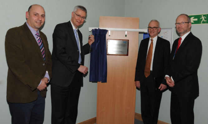 Dr Alex Baldacchino, NHS Fife director of R&D, Professor Andrew Morris, Professor David Crossman and Dr Brian Montgomery, NHS Fife interim chief executive, at the opening of the clinical research facility at Victoria Hospital, Kirkcaldy.