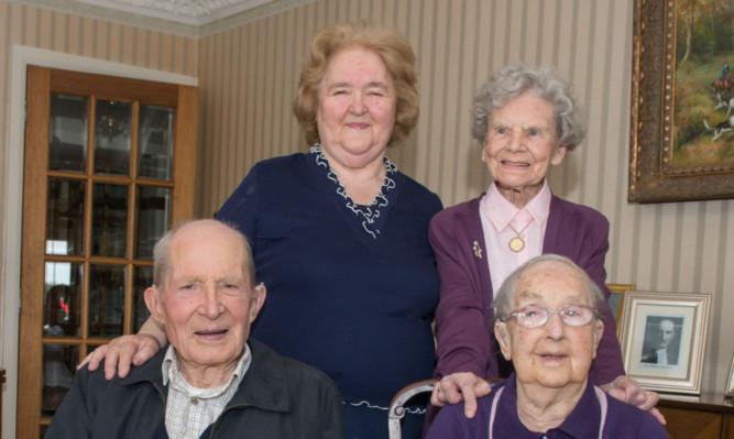 Centenarians Jessie Sinclair, back, Alf Smith and Willhelmina (Neen) Reid with host Sheena Baptie enjoying a cup of tea.