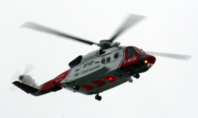 A Coastgurad helicopter involved in the search for a missing plane at Dundee Airport.