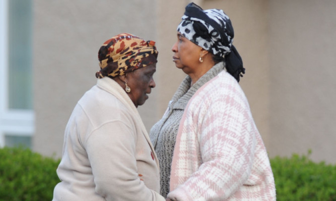 Sheku Bayoh's mother, right, was joined by friends and family at a gathering in Kirkcaldy on Wednesday night.