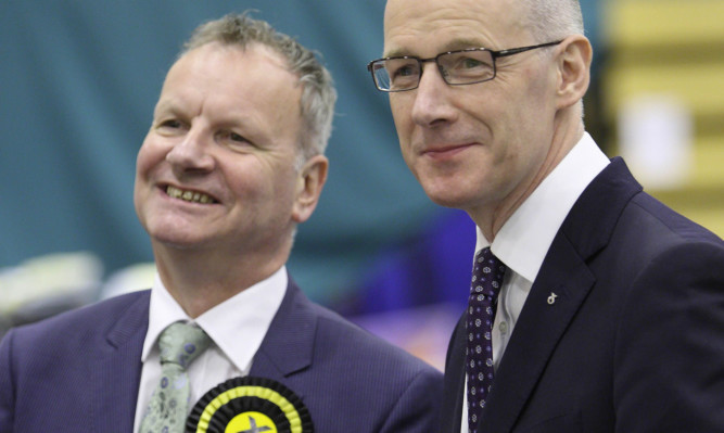 The SNP's Pete Wishart and John Swinney are all smiles at the Perth count.