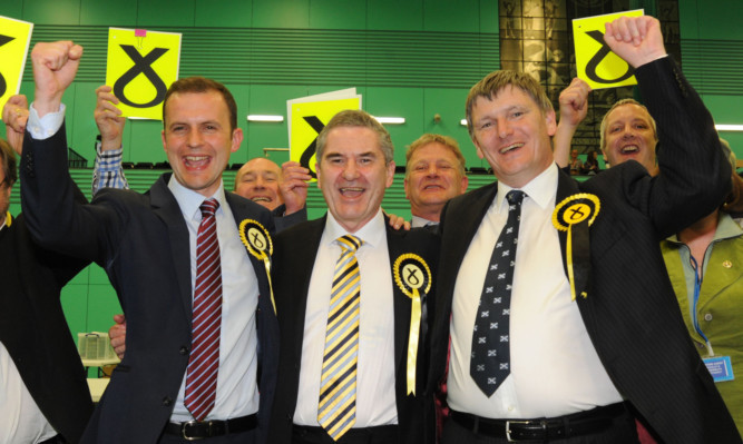 Stephen Gethins (left) celebrates the SNP's Fife clean sweep with fellow new MPs Roger Mullin and Peter Grant.