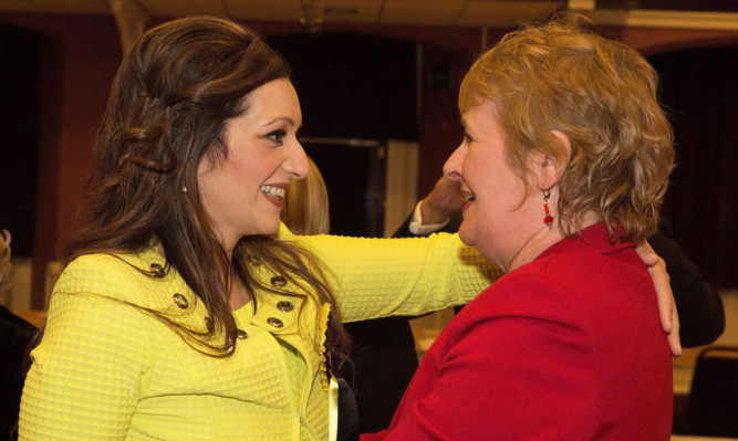 Tasmina Ahmed-Sheikh celebrating with Perthshire South and Kinross-shire MSP Roseanna Cunningham.