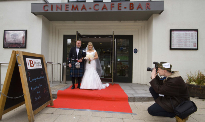 Katherine Dodds and Scott Rix were married at the Birks Cinema. Right: Anthony Smith, kitchen assistant at the Birks Cinema, pretending to be paparazzi.