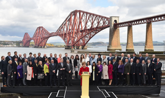 Nicola Sturgeon with her 56 SNP MPs at a photocall on Saturday morning.