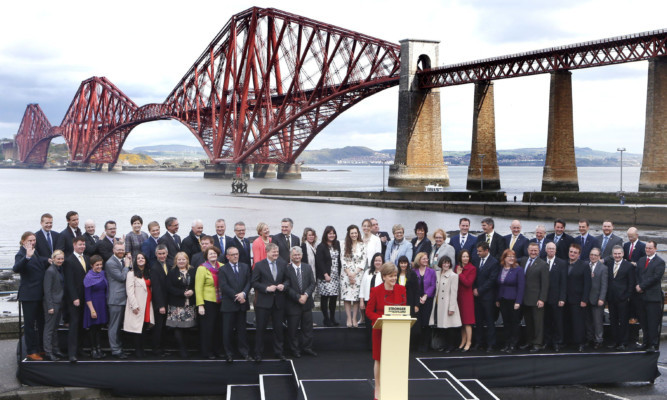 Nicola Sturgeon speaks, with the party's MPs gathered near the Forth Bridge.