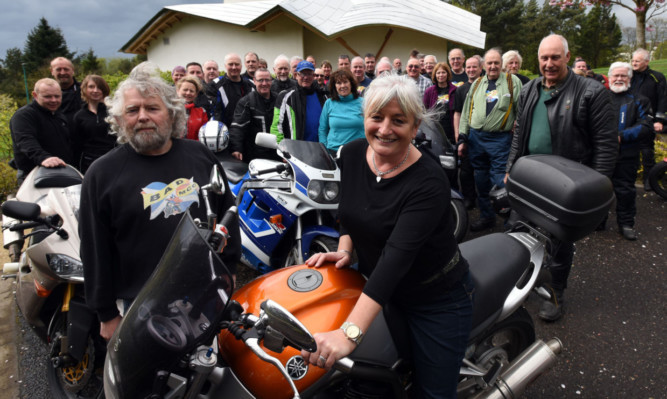 Club member and organiser Charlie Crichton and Val Busher, centre fundraising manager, with the bikers at the centre.
