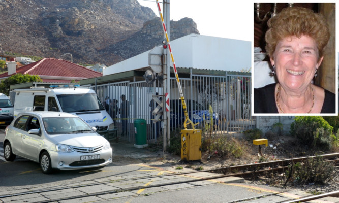 The remains of Sandra Malcolm (inset) were found in a flat at the Capri Mews complex in Cape Town.