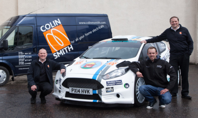 Roland Smith (left) and Jonathen Smith (right) with rally driver John MacCrone.