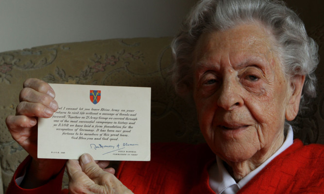 Christina Rae with a personal signed card from Field Marshal Montgomery.