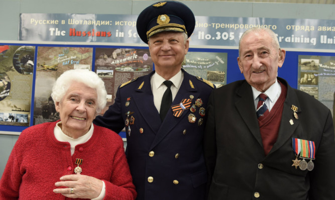 Mrs Ness Vann and Mr David Oswald, right, were presented with Russian 70th anniversary medals by Soviet pilot Alexei Timofeev.