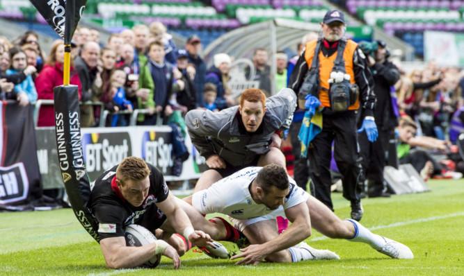 Edinburgh's Dougie Fife (left) comes close to scoring a try.