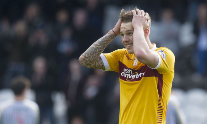 Dejection at full-time for Motherwell's Lee Erwin