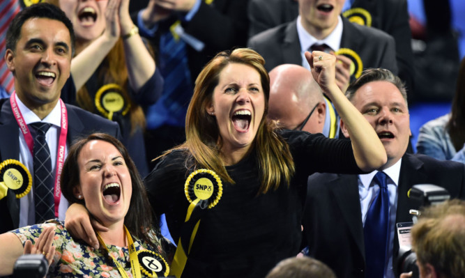 SNP supporters celebrating on what was a disastrous election night for Scottish Labour.
