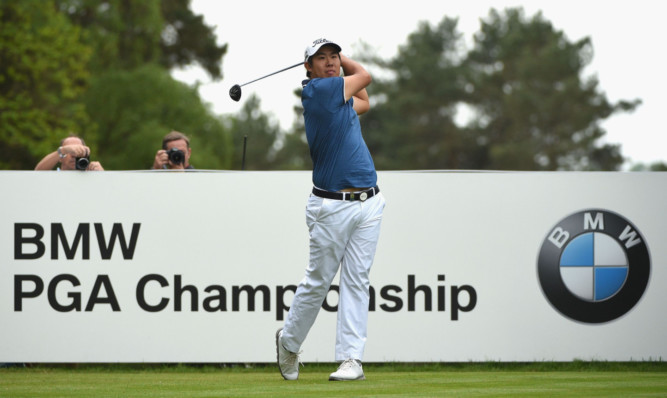 Byeong-Hun An tees off at the 15th during his final round 65 at Wentworth.