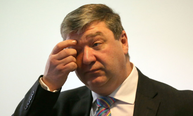 Alistair Carmichael has faced calls to quit as an MP.