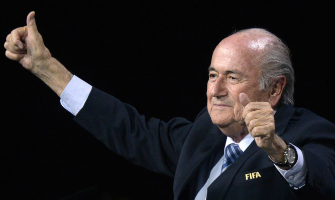 FIFA president Sepp Blatter gestures after his re-election during the 65th FIFA Congress.
