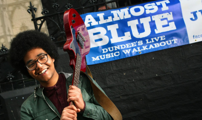Ahmed Khogali preparing for Dundees Almost Blue festival.