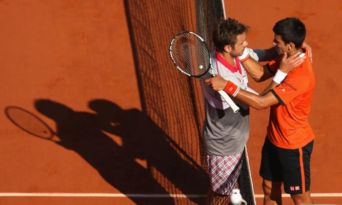 Novak Djokovic (right) was gracious in defeat to Stan Wawrinka.