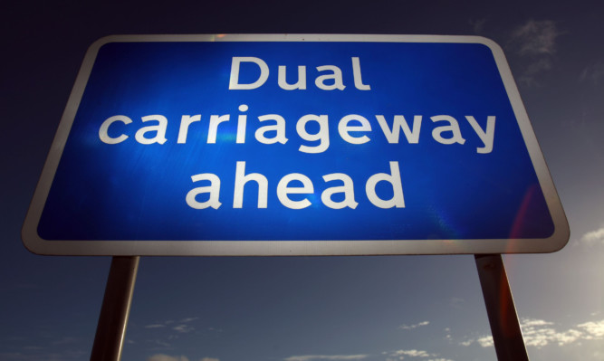 Kris Miller, Courier, 06/11/13. Picture today shows Dual Carriageway ahead sign near Luncarty on the A9 for files.