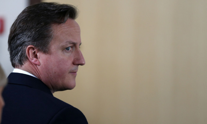 """Prime Minister David Cameron says the figures show shows """"Britain is the place to do business."""""""