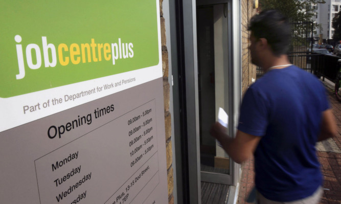 File photo dated 16/09/14 of the entrance to a Jobcentre Plus near Westferry in East London, as the Prime Minister vowed to end youth unemployment in the next Parliament as the Tories set out details of the welfare squeeze that will pay for their plan to create millions of new apprenticeships. PRESS ASSOCIATION Photo. Issue date: Monday October 20, 2014. An extra 40,000 households will be hit as the benefits cap is reduced from £26,000 to £23,000 under the policy, saving £135 million a year. See PA story POLITICS Benefits. Photo credit should read: Philip Toscano/PA Wire