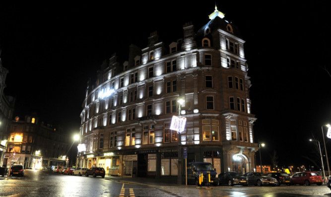 Dundee's Malmaison hotel lit up at night