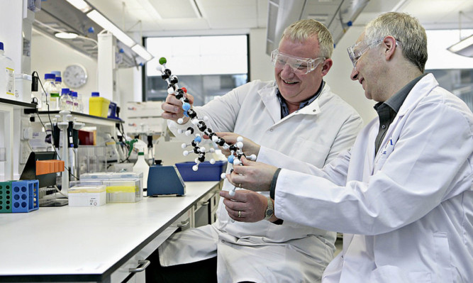 Dr Kevin Read, left, and Professor Ian Gilbert, lead researchers on the project, which has seen its findings published in Nature, with a model of the compound.
