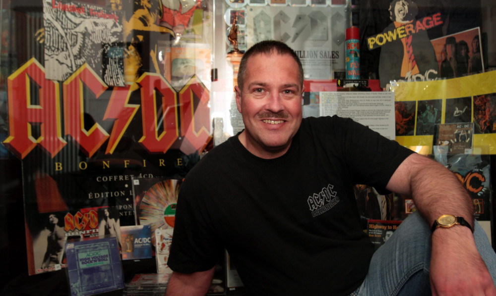 Neil McDonald with some of his extensive collection of Bon Scott and AC/DC memorabilia.