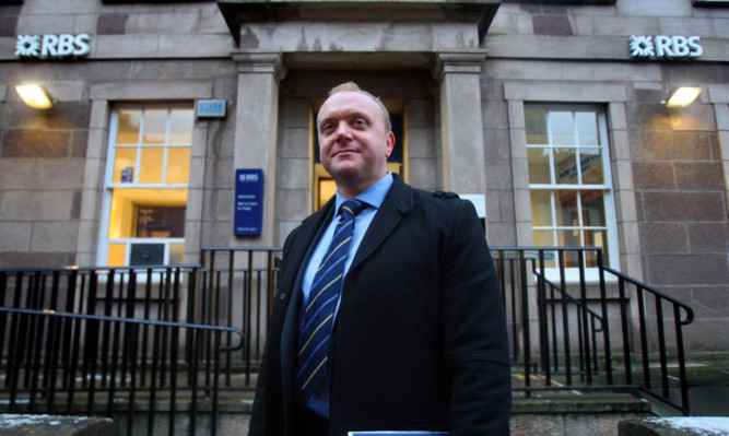 Detective Sergeant Murray Coull outside the Kirriemuir branch of RBS.
