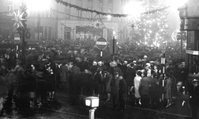 People celebrating Hogmanay in City Square in the 1960s.
