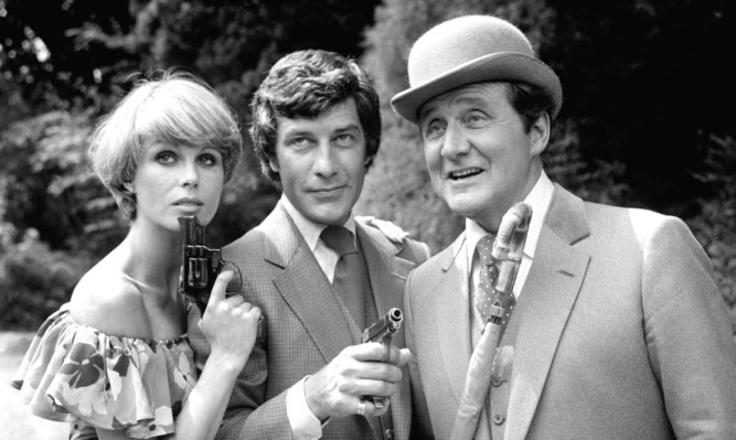 Patrick Macnee as the cool, bowler-hatted John Steed, with Purdey played by Joanna Lumley and Gareth Hunt as Mike Gambit.