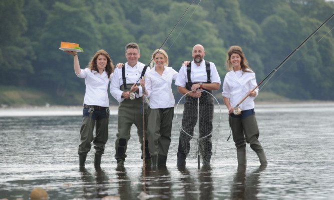 In the Tay, next to Scone Palace, are, from left, Nichola Reith, Christopher Trotter, Gillian Reith, Tom Lewis and Linsey Reith.