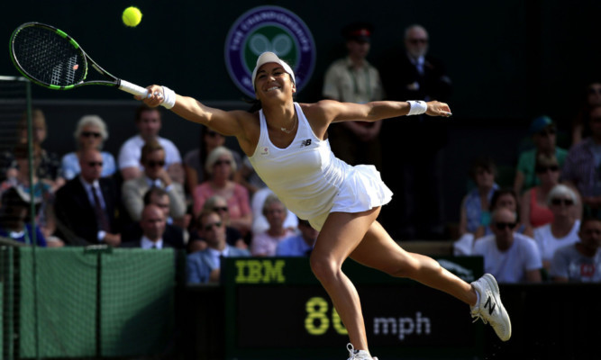 Heather Watson stretches for a shot against Serena Williams during day Five of the Wimbledon Championships at the All England Lawn Tennis and Croquet Club, Wimbledon. PRESS ASSOCIATION Photo. Picture date: Friday July 3, 2015.  See PA Story TENNIS Wimbledon. Photo credit should read Jonathan Brady/PA Wire. RESTRICTIONS: Editorial use only. No commercial use without prior written consent of the AELTC. Still image use only - no moving images to emulate broadcast. No superimposing or removal of sponsor/ad logos. Call +44 (0)1158 447447 for further information.