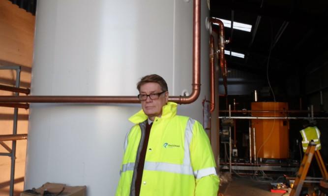 Nigel Perkins with a Raggnar biomass system.