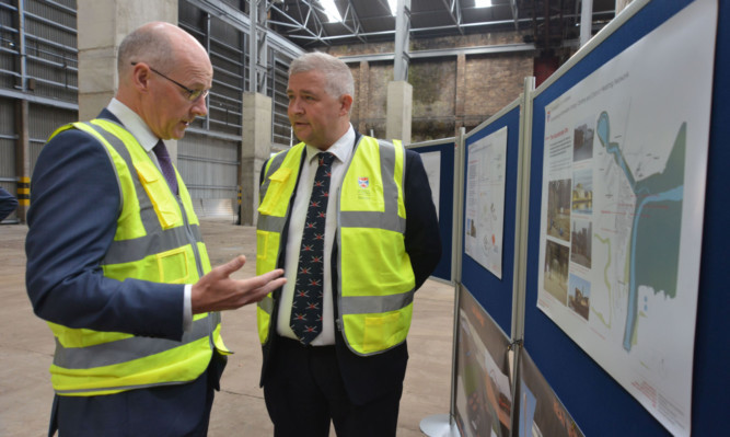 Deputy First Minister John Swinney visits the former paper mill at Guardbridge.