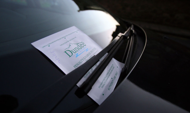 Kris Miller, Courier, 07/02/15. Picture today shows general view of a parking ticket on a car in Dundee City Centre for files.