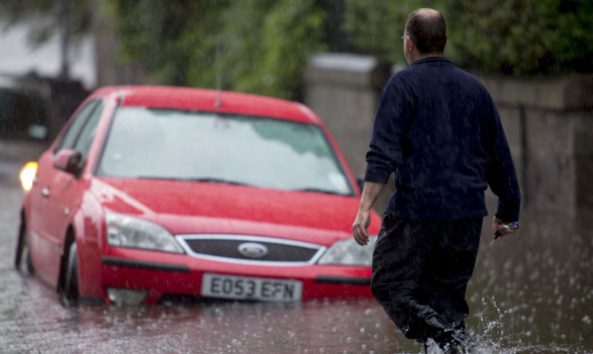 Flooding made Polmuir Road in Aberdeen impassable.