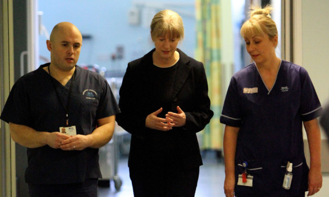 Cabinet secretary for health Shona Robison, centre, with consultant Andrew Reddick and specialist charge nurse Moira Raitt during a visit to Ninewells Hospital. Jenny says the SNPs record on health is a poor one.