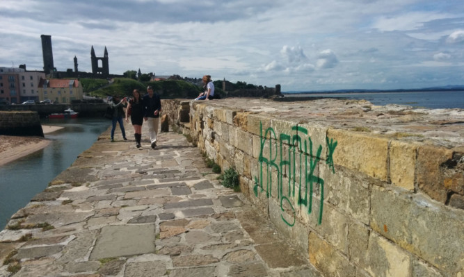 The tag on the harbour wall.