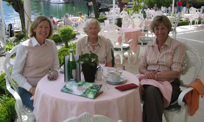 Margaret Phillips (centre) says a love of curry and a dram before bed has helped her enjoy a long life.
