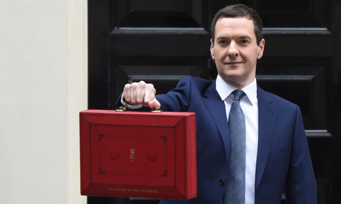 Chancellor of the Exchequer George Osborne holds his ministerial red box up as he leaves 11 Downing Street.