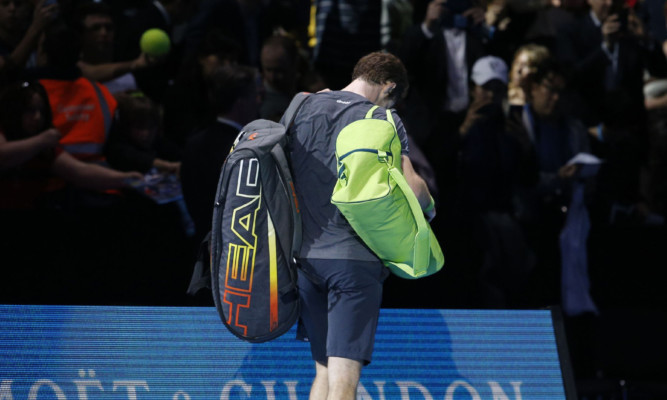 Andy Murray leaves court after his 6-0 6-1 defeat to Roger Federer in London last November.