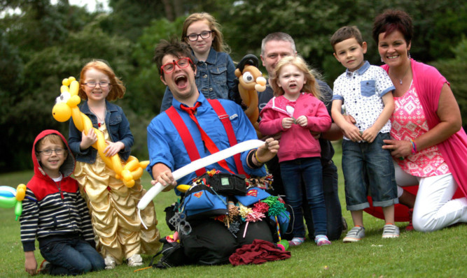 Entertainer Talented Ted makes balloon animals for visitors to the Gala in the Garden at Barnhill Rock Garden to celebrate the attractions 60 years.