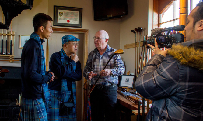 China Golf Channel filming at Simpsons golf shop in Carnoustie.