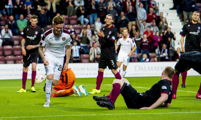 Jordan McGhee wheels away to celebrate his leveler for Hearts.